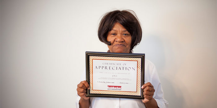 joyce holds appreciation certificate